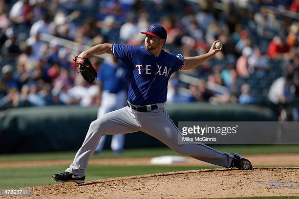 Ryan Feierabend of the Texas Rangers pitches during the spring training game against the Kansas City Royals at Surprise Stadium on February 27 2014...