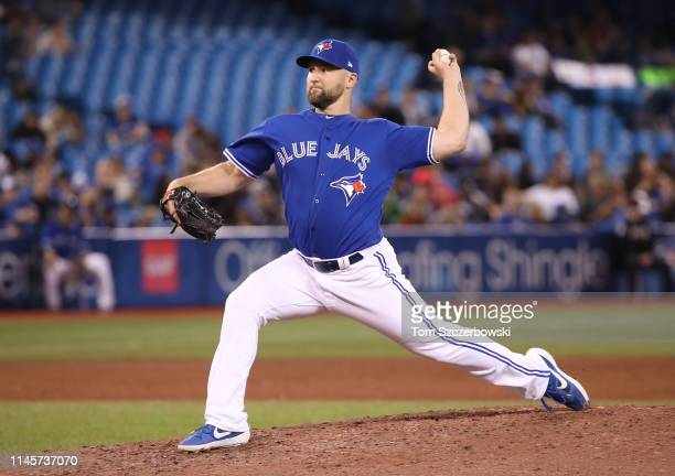 Ryan Feierabend of the Toronto Blue Jays delivers a pitch in the eighth inning during MLB game action against the Boston Red Sox at Rogers Centre on...