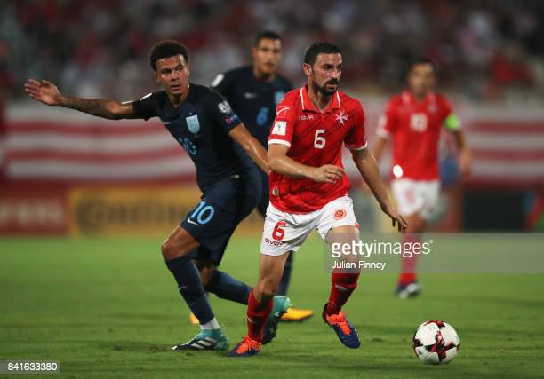 Ryan Fenech of Malta evades Dele Alli of England during the FIFA 2018 World Cup Qualifier between Malta and England at Ta'Qali National Stadium on...