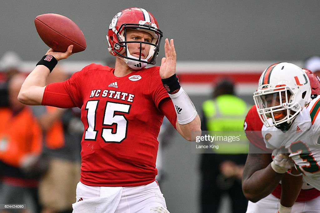 Ryan Finley #15 of the North Carolina State Wolfpack drops back to pass against the Miami Hurricanes at Carter-Finley Stadium on November 19, 2016 in Raleigh, North Carolina. Miami won 27-13.