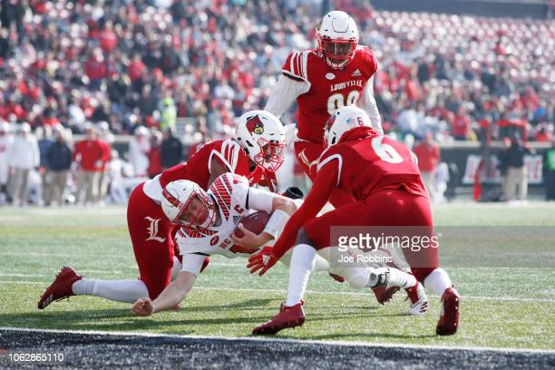 Ryan Finley of the North Carolina State Wolfpack gets stopped short of the goal line in the second quarter of the game against the Louisville...