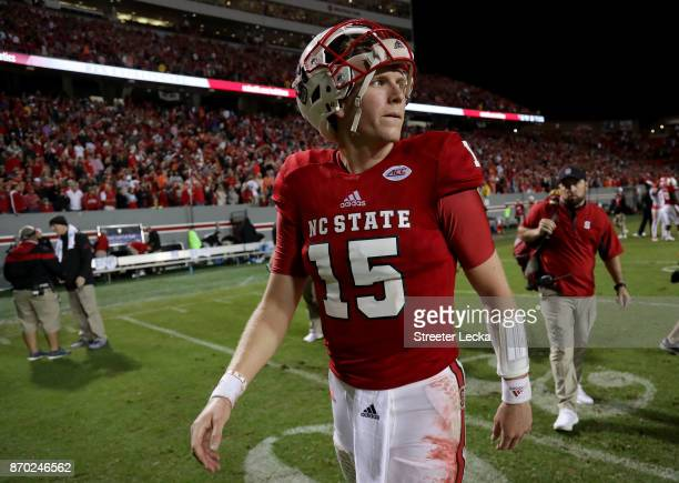 Ryan Finley of the North Carolina State Wolfpack walks off the field after being defeated by the Clemson Tigers 38-31 at Carter Finley Stadium on...
