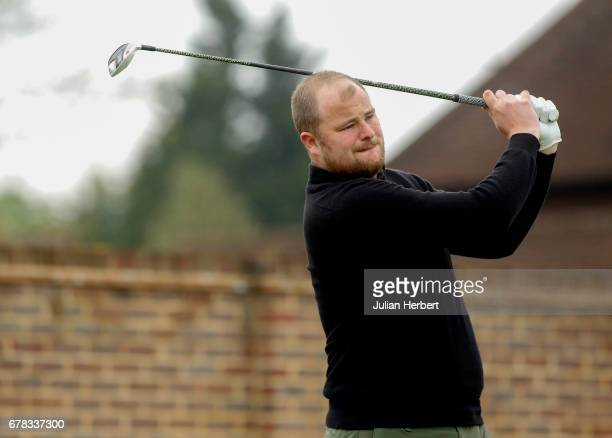 Ryan Fitzgerald of Burgess Hill Golf Academy plays his first shot on the 1st tee during the PGA Professional Championship South Qualifier at Sonning...