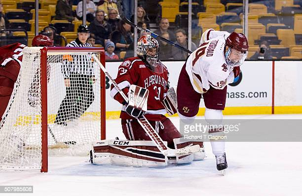 Ryan Fitzgerald of the Boston College Eagles trips over Merrick Madsen of the Harvard Crimson during NCAA hockey in the semifinals of the annual...