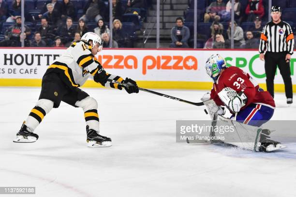Ryan Fitzgerald of the Providence Bruins is stopped by goaltender Connor LaCouvee of the Laval Rocket in a shootout during the AHL game at Place Bell...