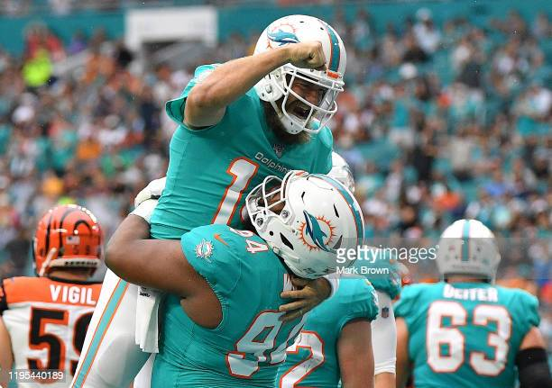 Ryan Fitzpatrick and Christian Wilkins of the Miami Dolphins celebrate touchdown against the Cincinnati Bengals in the first quarter at Hard Rock...