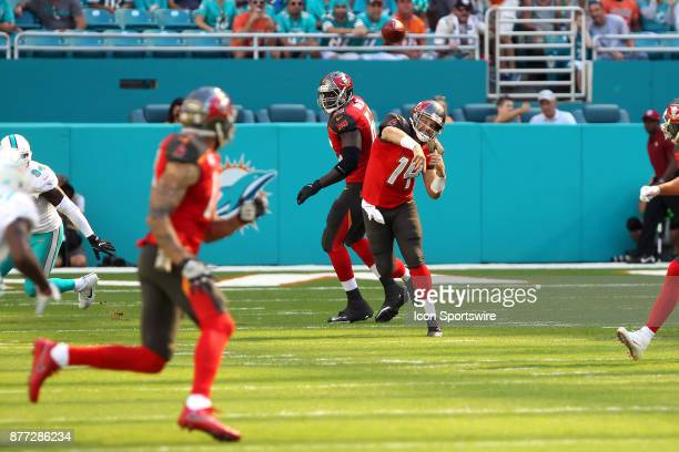 Ryan Fitzpatrick of the Bucs throws the ball upfield to Mike Evans during game between the Tampa Bay Buccaneers and the Miami Dolphins on Sunday Nov...