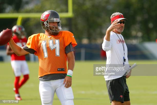 Ryan Fitzpatrick of the Bucs warms up as Head Coach Dirk Koetter looks on during the joint training camp work out between the Tampa Bay Buccaneers...