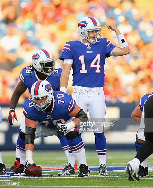 Ryan Fitzpatrick of the Buffalo Bills calls signals behind Eric Wood against the Jacksonville Jaguars at Ralph Wilson Stadium on August 27 2011 in...