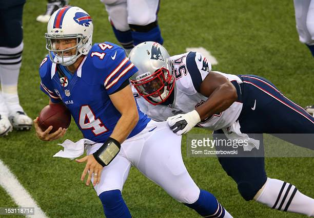 Ryan Fitzpatrick of the Buffalo Bills is tackled by Dont'a Hightower of the New England Patriots during an NFL game at Ralph Wilson Stadium on...