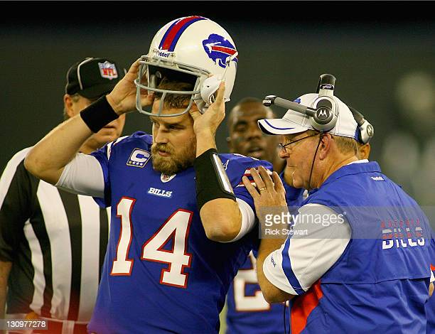 Ryan Fitzpatrick of the Buffalo Bills listens to head coach Chan Gailey during a time out against the Washington Redskins at Rogers Centre on October...