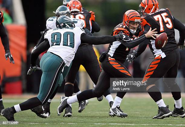 Ryan Fitzpatrick of the Cincinnati Bengals is tackled by Darren Howard of the Philadelphia Eagles during the NFL game at Paul Brown Stadium on...