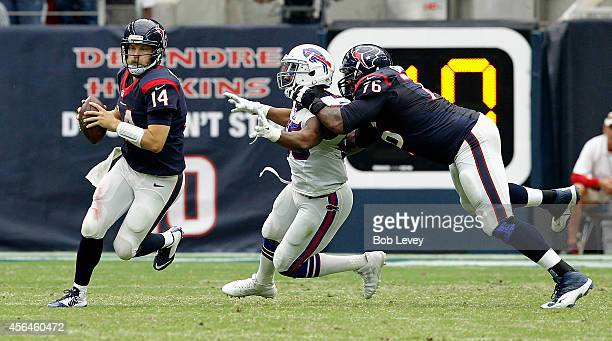 Ryan Fitzpatrick of the Houston Texans rolls out as he gets a block from Duane Brown at NRG Stadium on September 28, 2014 in Houston, Texas.