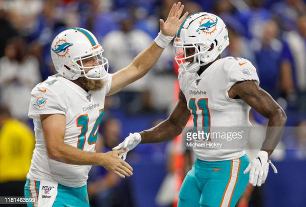 Ryan Fitzpatrick of the Miami Dolphins and DeVante Parker of the Miami Dolphins celebrate a touchdown during the first half against the Indianapolis...