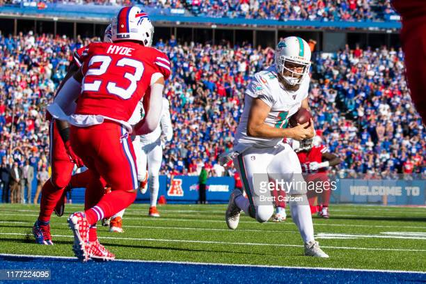 Ryan Fitzpatrick of the Miami Dolphins carries the ball for a touchdown during the fourth quarter against the Buffalo Bills at New Era Field on...