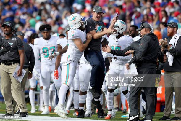 Ryan Fitzpatrick of the Miami Dolphins celebrates after throwing a touchdown pass during the second quarter of an NFL game against the Buffalo Bills...