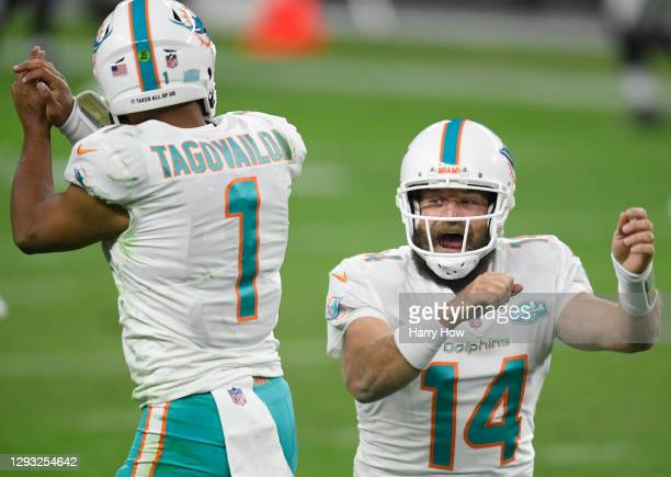 Ryan Fitzpatrick of the Miami Dolphins celebrates his touchdown pass with Tua Tagovailoa, to take a 23-22 lead over the Las Vegas Raiders, during the...