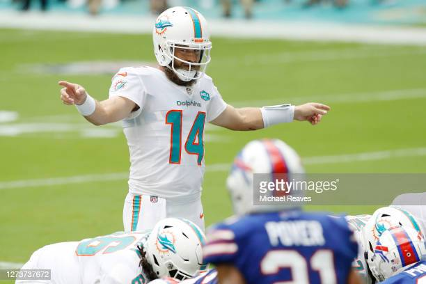 Ryan Fitzpatrick of the Miami Dolphins directs the offense against the Buffalo Bills during the first half at Hard Rock Stadium on September 20, 2020...