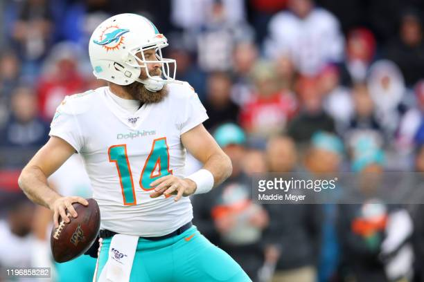 Ryan Fitzpatrick of the Miami Dolphins looks to pass against the New England Patriots at Gillette Stadium on December 29, 2019 in Foxborough,...