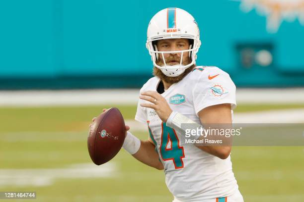 Ryan Fitzpatrick of the Miami Dolphins looks to pass against the New York Jets at Hard Rock Stadium on October 18, 2020 in Miami Gardens, Florida.