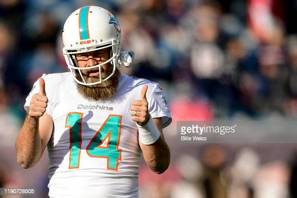 Ryan Fitzpatrick of the Miami Dolphins reacts before a game against the New England Patriots at Gillette Stadium on December 29, 2019 in Foxborough,...