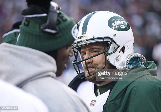 Ryan Fitzpatrick of the New York Jets and head coach Todd Bowles on the sideline against the Buffalo Bills during NFL game action at Ralph Wilson...