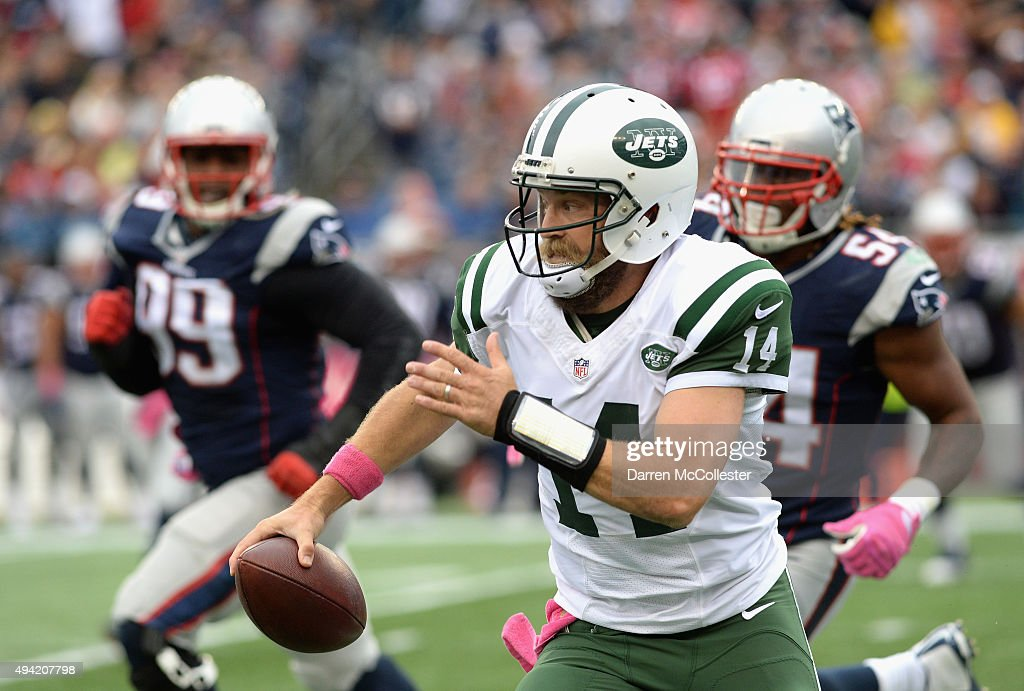 Ryan Fitzpatrick #14 of the New York Jets carries the ball during the second quarter against the New England Patriots at Gillette Stadium on October 25, 2015 in Foxboro, Massachusetts.