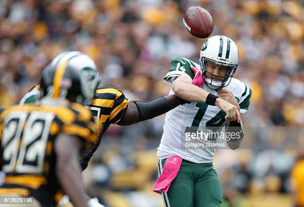 Ryan Fitzpatrick of the New York Jets gets a pass knocked out of his hand during the first quarter by Arthur Moats of the Pittsburgh Steelers at...