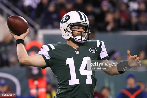 Ryan Fitzpatrick of the New York Jets looks to throw a pass against the New England Patriots in the game at MetLife Stadium on November 27 2016 in...