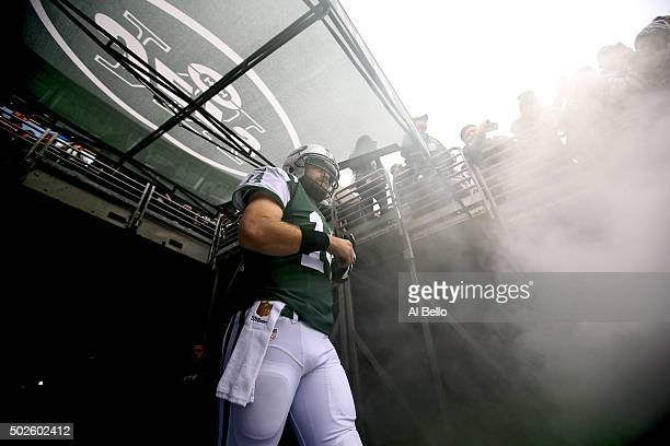 Ryan Fitzpatrick of the New York Jets prepares to take the field prior to their game against the New England Patriots at MetLife Stadium on December...