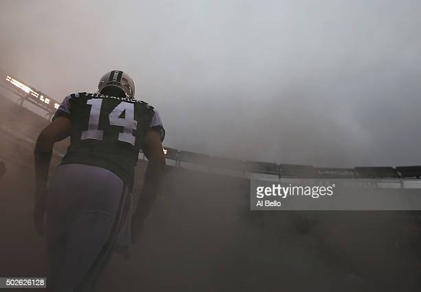 Ryan Fitzpatrick of the New York Jets runs onto the field against the New England Patriots before their game at MetLife Stadium on December 27 2015...