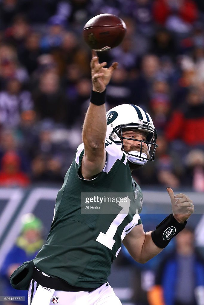 Ryan Fitzpatrick #14 of the New York Jets throws a pass against the New England Patriots during the first quarter in the game at MetLife Stadium on November 27, 2016 in East Rutherford, New Jersey.