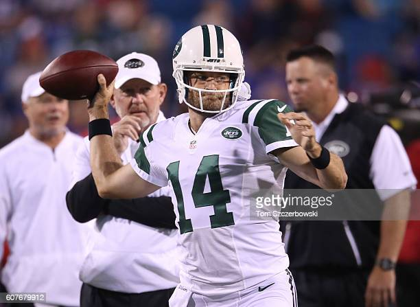 Ryan Fitzpatrick of the New York Jets throws as offensive coordinator Chan Gailey watches during pregame warmups before the start of NFL game action...