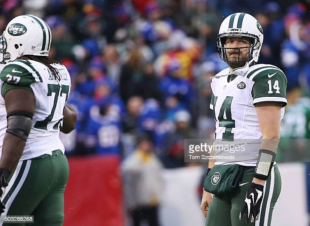 Ryan Fitzpatrick of the New York Jets walks off the field after an interception against the Buffalo Bills at Ralph Wilson Stadium on January 3 2016...