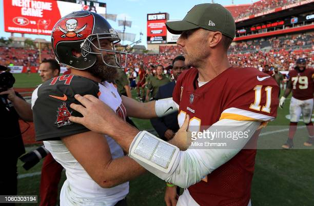 Ryan Fitzpatrick of the Tampa Bay Buccaneers and Alex Smith of the Washington Redskins shake hands during a game at Raymond James Stadium on November...