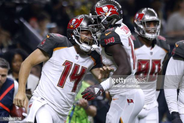 Ryan Fitzpatrick of the Tampa Bay Buccaneers celebrates a touchdown with Justin Watson during the first half against the New Orleans Saints at the...