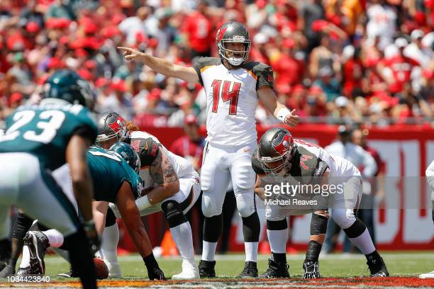 Ryan Fitzpatrick of the Tampa Bay Buccaneers directs the offense against the Philadelphia Eagles during the first half at Raymond James Stadium on...