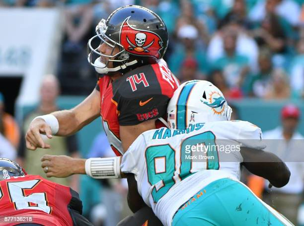 Ryan Fitzpatrick of the Tampa Bay Buccaneers hit by Charles Harris of the Miami Dolphins in the third quarter at Hard Rock Stadium on November 19...
