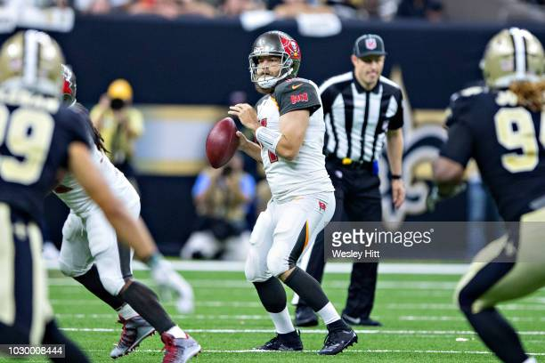 Ryan Fitzpatrick of the Tampa Bay Buccaneers looks downfield for an open receiver during a game against the New Orleans Saints at MercedesBenz...