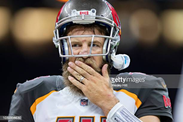 Ryan Fitzpatrick of the Tampa Bay Buccaneers on the sidelines during a timeout against the New Orleans Saints at MercedesBenz Superdome on September...