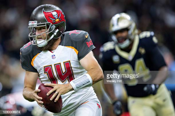 Ryan Fitzpatrick of the Tampa Bay Buccaneers runs the ball during a game against the New Orleans Saints at MercedesBenz Superdome on September 9 2018...