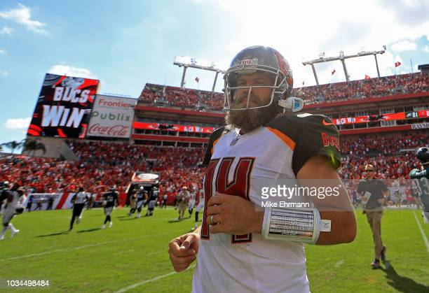 Ryan Fitzpatrick of the Tampa Bay Buccaneers walks off the field after winning a game against the Philadelphia Eagles at Raymond James Stadium on...
