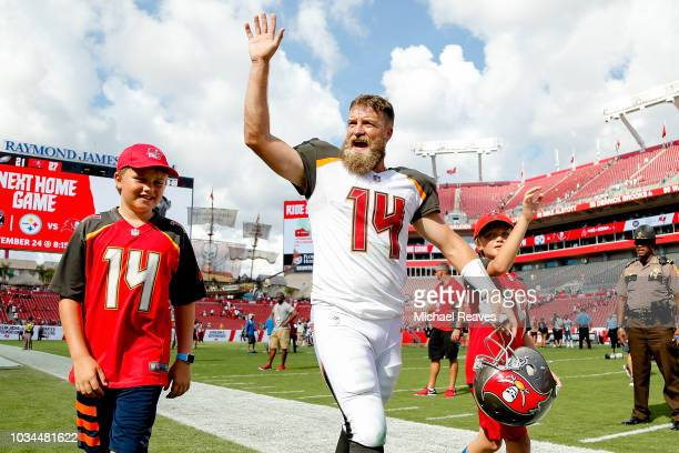 Ryan Fitzpatrick of the Tampa Bay Buccaneers waves to the crowd after they defeated the Philadelphia Eagles 2721 at Raymond James Stadium on...