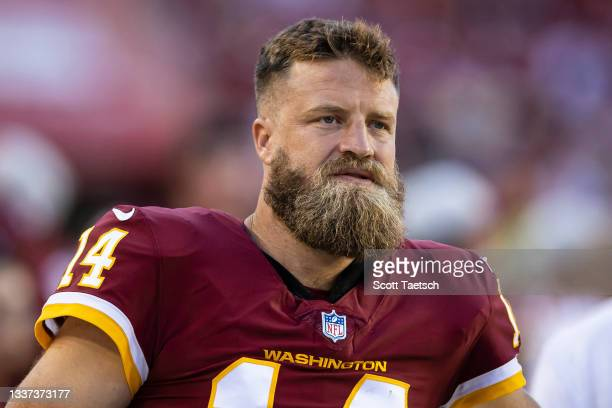 Ryan Fitzpatrick of the Washington Football Team looks on while sitting out the preseason game against the Baltimore Ravens at FedExField on August...