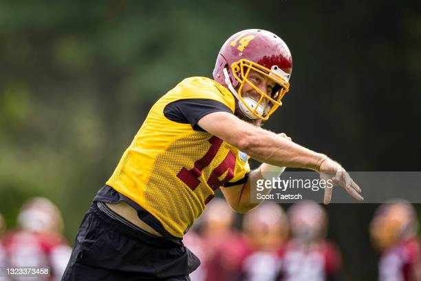 Ryan Fitzpatrick of the Washington Football Team looks to pass during mandatory minicamp at Inova Sports Performance Center on June 10, 2021 in...