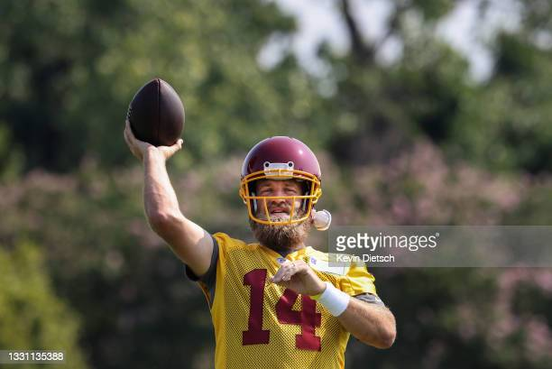 Ryan Fitzpatrick of the Washington Football Team passes during the Washington Football Team training camp on July 28, 2021 in Richmond, Virginia.