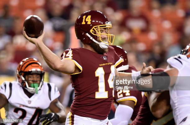 Ryan Fitzpatrick of the Washington Football Team throws a pass against the Cincinnati Bengals during the NFL preseason game at FedExField on August...