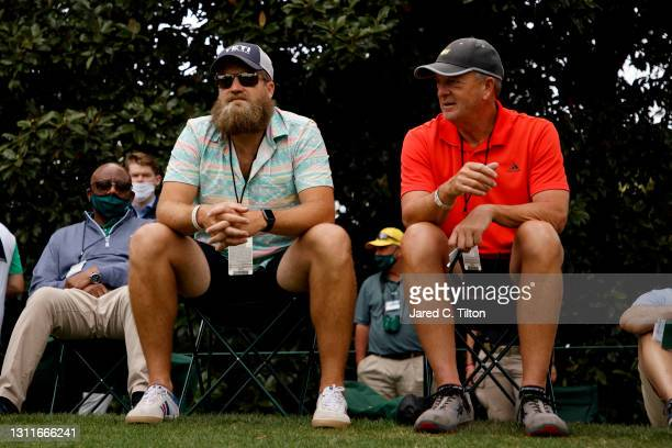 Ryan Fitzpatrick of the Washington Football Team watches play on the eighth green during the second round of the Masters at Augusta National Golf...