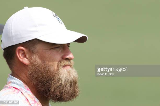 Ryan Fitzpatrick of the Washington Football Team watches play on the second green during the final round of the Masters at Augusta National Golf Club...