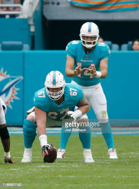 Ryan Fitzpatrick waits for the snap by Daniel Kilgore of the Miami Dolphins xx of the Buffalo Bills during an NFL game on November 17, 2019 at Hard...